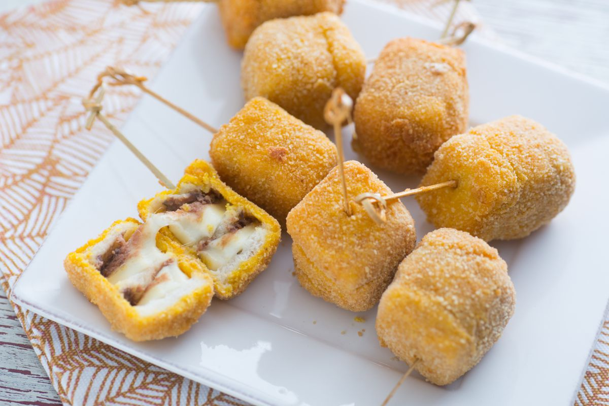 Fried mozzarella and anchovy skewers