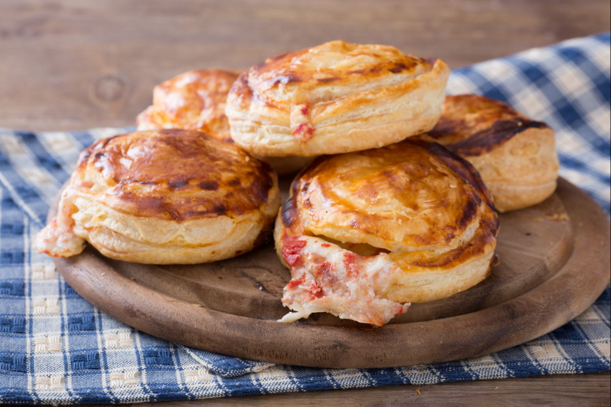 Rustici leccesi (Puff pastry appetizers with béchamel, mozzarella, and tomato)