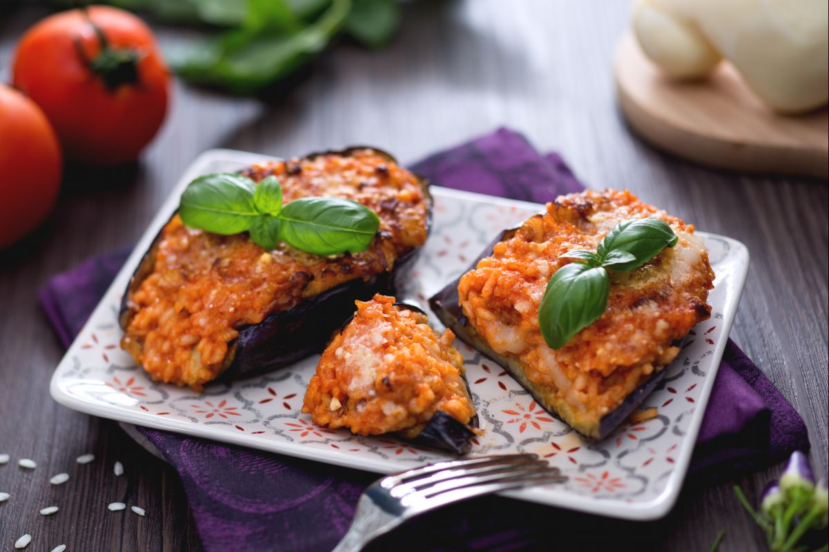 Cheesy rice-stuffed eggplant