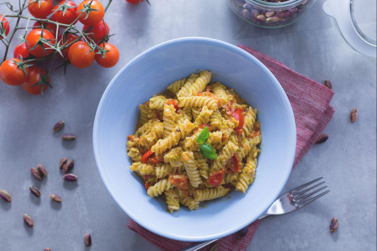 Fusilli pasta with pistachio pesto and cherry tomatoes